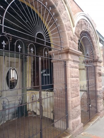 A gated brick building with arched entryways in Jerome Arizona