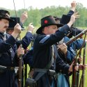 Gettysburg reenactment actors loading arrows into their bows.