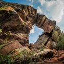 Natural rock forms an arch on a sunny day in Boulder, Colorado along the Royal Arch Trail