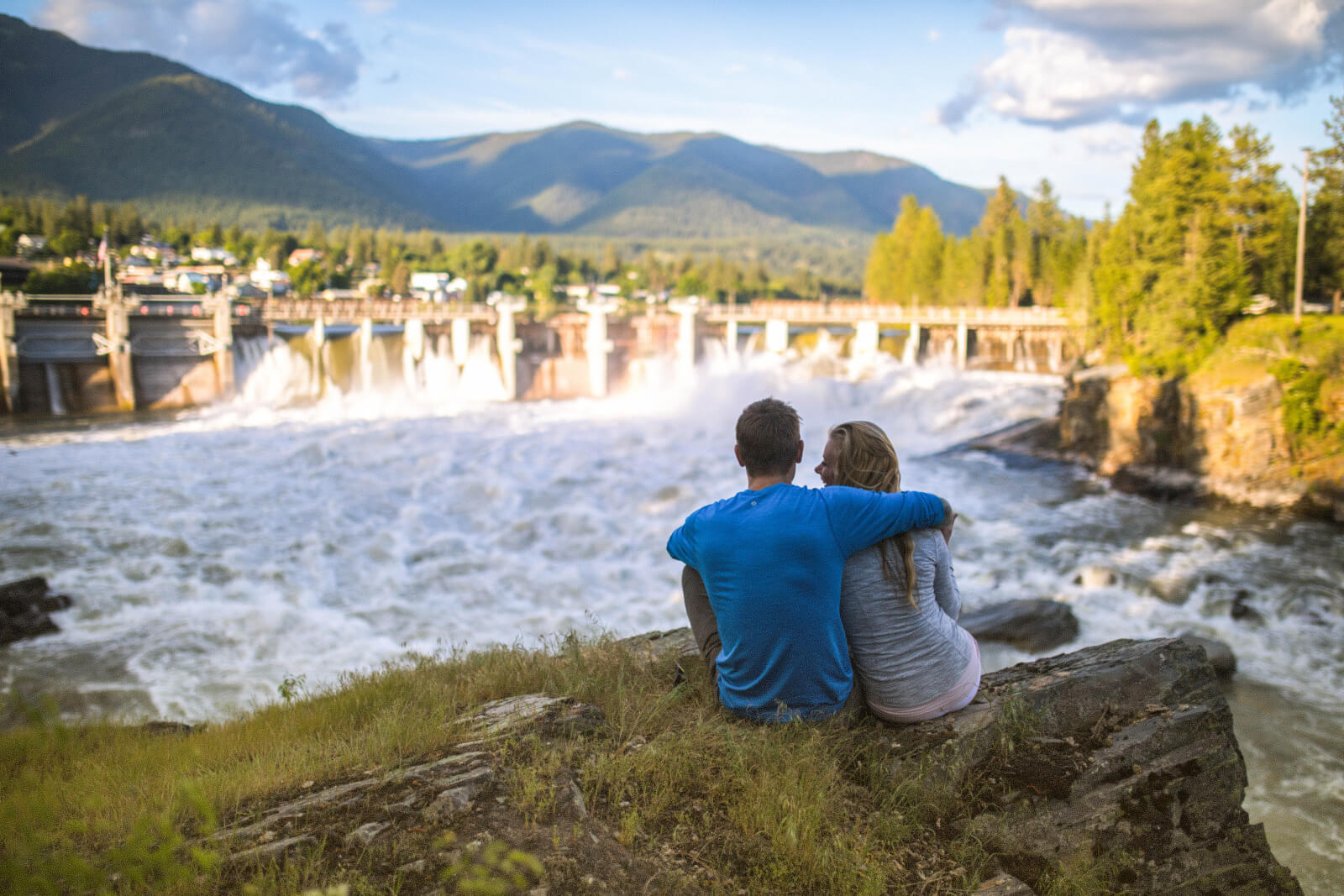 Couple overlooking scenic dam in Thompson Falls, Montana