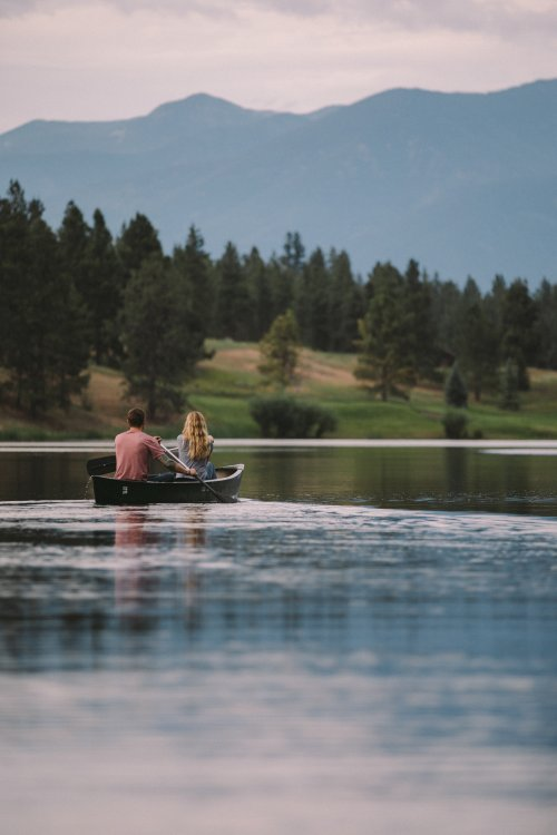 Visitors paddling on a lake in Glacier Country, Montana
