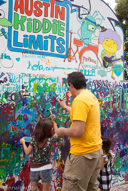 Family painting a wall at Austin Kiddie Limits part of Austin City Limits Music Festival