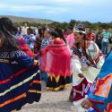 A group of Hualapai women dance in tradition colorful dresses at Grand Canyon West