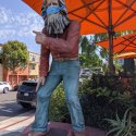 Masked statue points the way in Laguna Beach, California