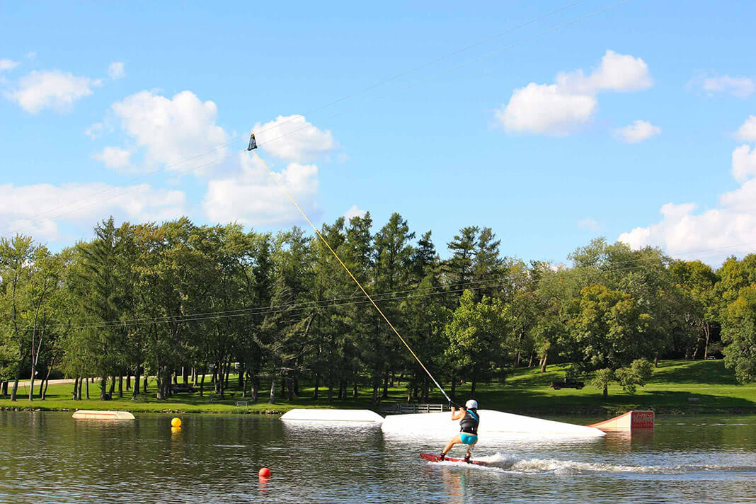 Wake boarder on the cable system at West Rock Wake Park on Levings Lake in Rockford, IL.