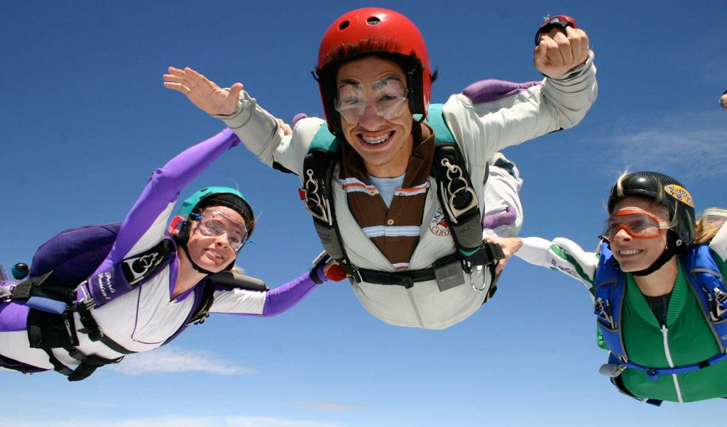 Three skydivers in the air of South Carolina's Olde English District