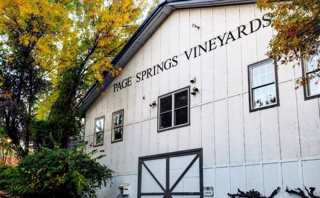 The black and white barn-face facade of Page Springs Vineyards in Cornville, Arizona.