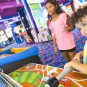 A young boy and girl playing games in Arcade City in Table Rock Lake